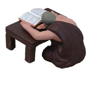 お坊さんの授業中に机に伏して居眠りしている小僧さんが切り抜かれた写真